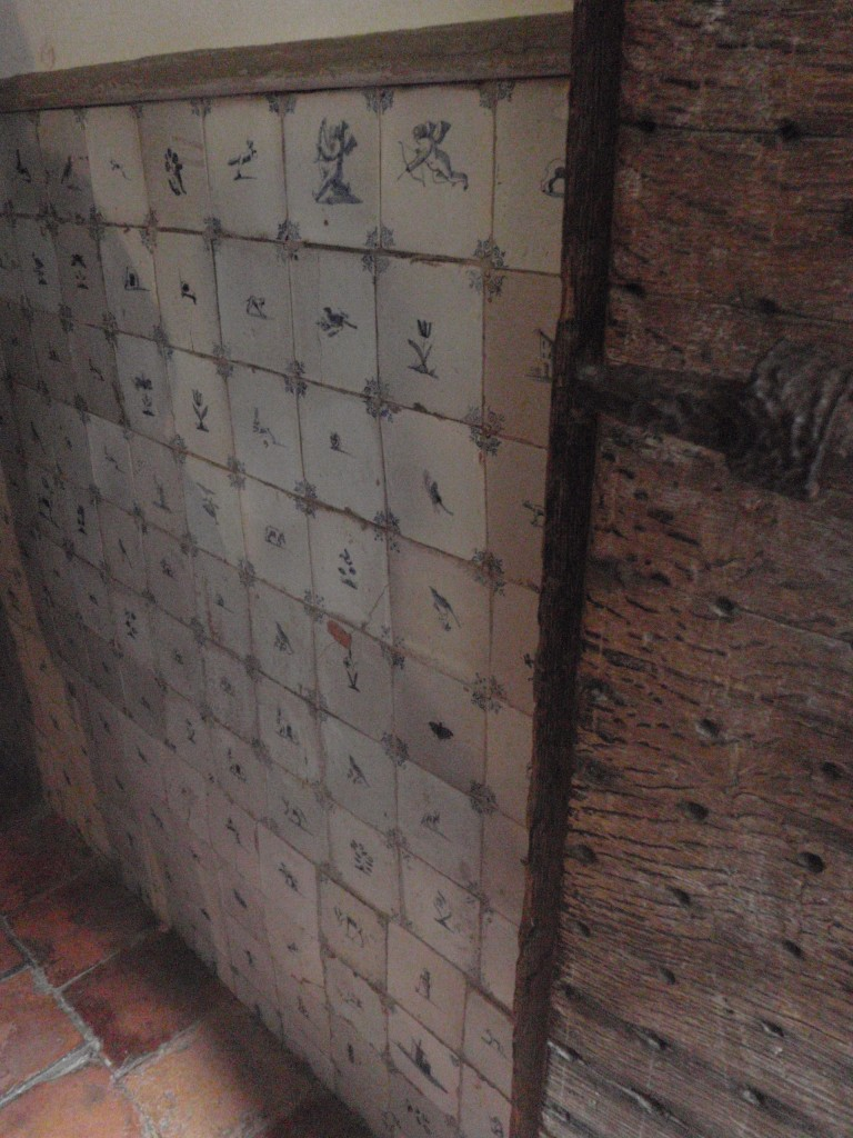 Rejected Delft tiles along the torture room's walls, used to make it easier to clean..