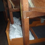 Small, cramped beds in the attic.